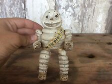 Antique Cast Iron Michelin Tire Man Figure , Glass Eyes, Sitting Position