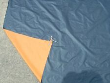 Parachute material, one side black, other side orange, priced by the yard