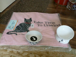 Brand new beautiful cat mat, a ceramic bowl and a ceramic raised food bowl.