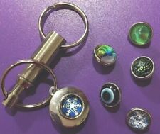 6 Snap Multicolor Silver Push-And-Release Keychain. Snowflake Blue Green Eyeball