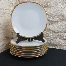 RAYNAUD LIMOGES / 8 assiettes plates en porcelaine décor blanc et or