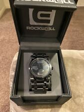 NEW IN BOX MENS Rockwell 50mm Round Watch Black on Black W/Silver Numbering.