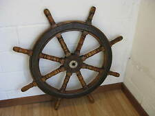 A Large Wooden Antique Ship's Wheel