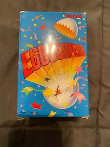 TAKARA EGGSCAPERS DINOSAUR WIND UP TOY 1998 MINT IN BOX.  EGG STILL SEALED  NOS