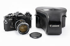 (177) Canon F-1n film camera w/58/1.2 lens, cap, leather case, in near Mint cond