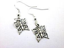 "Pendientes artesanales  "" Mariposa "" charm  en plata tibetana. ( Envios comb.)"