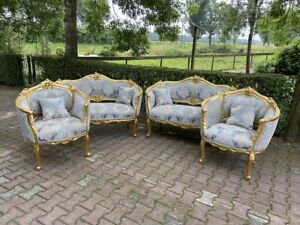 A Louis XVI Style pair corbeille sofa's with two chairs