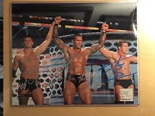 WWE Signed Legacy 8x10 (with Photo Proof) Orton Rhodes Dibiase