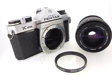 Pentax K1000, works great, internal meter fine, 2.8, 35/70mm zoom lens, exc.+++