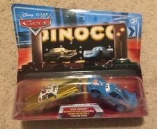 Disney Cars Movie Moments Blue Background Night Skyline Tex Dinoco McQueen