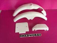 Guardabarros y faldones sin marca color principal blanco para motos