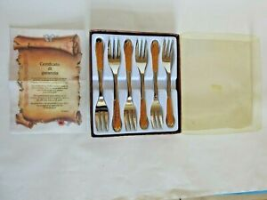 Set of 6 Inoxpran Linea Gold plated stainless steel cake forks in box .