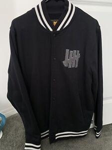Black Undefeated Varsity Bomber Jacket.  Size M. Preowned