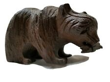 Black Forest brown hand carved bear with fish in mouth.