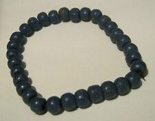 Great wooden beaded elasticated bracelet in blue.  Very rustic look