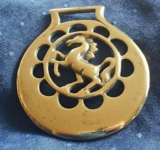 ANTIQUE CAST HORSE BRASS - A REARING HORSE IN CRESCENT MOONS
