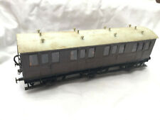 O GAUGE BRASS 6 WHEEL COACH WITH SEATED PASSENGERS '  G C R  ' ?
