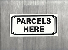 Parcels Here sign.   3mm thick Plastic Sign in black.   (BS-33)