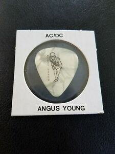 AC/DC Rare Guitar Pick (Let There Be Rock World  Tour 1977 ).