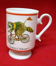 Older Coffee Mug Downhill Racer Racoon on Bicycle Pedistal Cup 4 1/4 Inches Tall