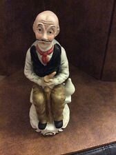 Flambro Fine Porcelain Old Man Sitting On A Bench Holding A Pipe