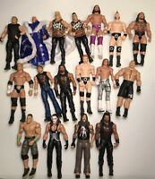 WWE Figures Lot Of 17. Conditon Is Used. Ric Flair, Nasty Boy, Macho Man, Sting