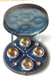 Solid silver Set of four salts, with spoons, cased. Goldsmiths & Silversmiths