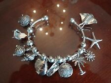 VINTAGE STERLING SILVER BANGLE 20 BEADS AND CHARMS TOTAL 925