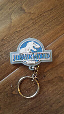 2014 UNIVERSAL STUDIOS AMBLIN JURASSIC WORLD PARK MOVIE PROMO KEYRING & LIGHT