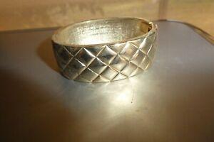 Gold  Plate Bangle with diamond shape indentation.