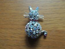 Vintage signed Warner CAT clear a/b Rhinestone brooch. Silver tone metal.