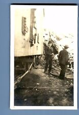 TRAIN WRECK  2 photo's.  Location ???   Writing on the back  Cannot make it out