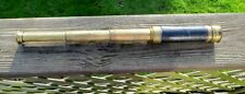 Three draw pocket telescope in brass and leather, good working order