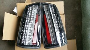 CADILLAC STS EURO CLEAR TAILLIGHTS PAIR SET NEW OEM GM