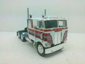 """1/63 DCP/FG Whit/Red/Purple Graphics 352 Peterbilt 110"""" Cabover Tractor"""