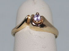 10k Gold ring with a Tanzanite(Dec birthstone) and a beautiful design