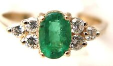 Ladies 14k yellow gold oval emerald and diamond ring