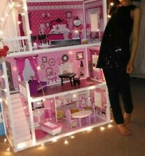 Girl  Dollhouse with accessories  in excellent condition.