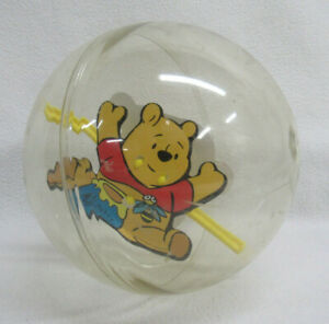 Plastic Rolling Spinning Winnie the Pooh in clear ball Baby Toy VTG