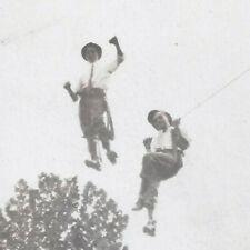 1910s RP POSTCARD PEOPLE 2 MEN STANDING FLOATING IN AIR WILD VIEW