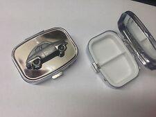 Saab 92 ref224 pewter effect car emblem on a silver metal pill box