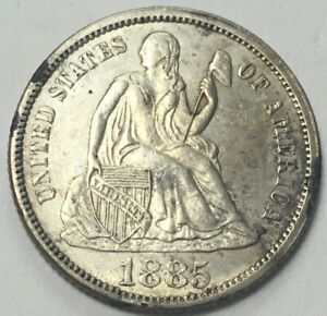 1885  SEATED DIME SOME MINT LUSTER ON MOSTLY WHITE COIN WITH TINY BIT OF WEAR