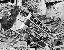Photo World War 2 bombing raid, a bus lies in a crater in Balham, South London
