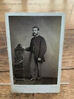 victorian photo -   victorian man holding onto a very ornate chair ! h.c. booth