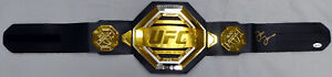JON BONES JONES AUTOGRAPHED UFC CHAMPIONSHIP REPLICA BELT IN GOLD BECKETT 185711
