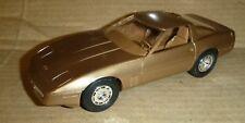 MPC 1986 CHEVY CORVETTE COUPE GOLD PROMO 1/25 Model Car Mountain