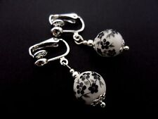 A PAIR OF SIMPLE PORCELAIN BLACK/WHITE FLOWER BEAD DROP CLIP ON  EARRINGS. NEW.