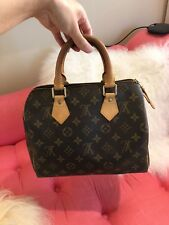 LOUIS VUITTON Brown Monogram Canvas Speedy 25 Bag