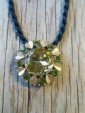 Avon pendant brooch gold tone peridot rhinestones with black cord necklace