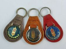 Lot of 3 Vintage Oldsmobile leather keychain keyring metal back Blue